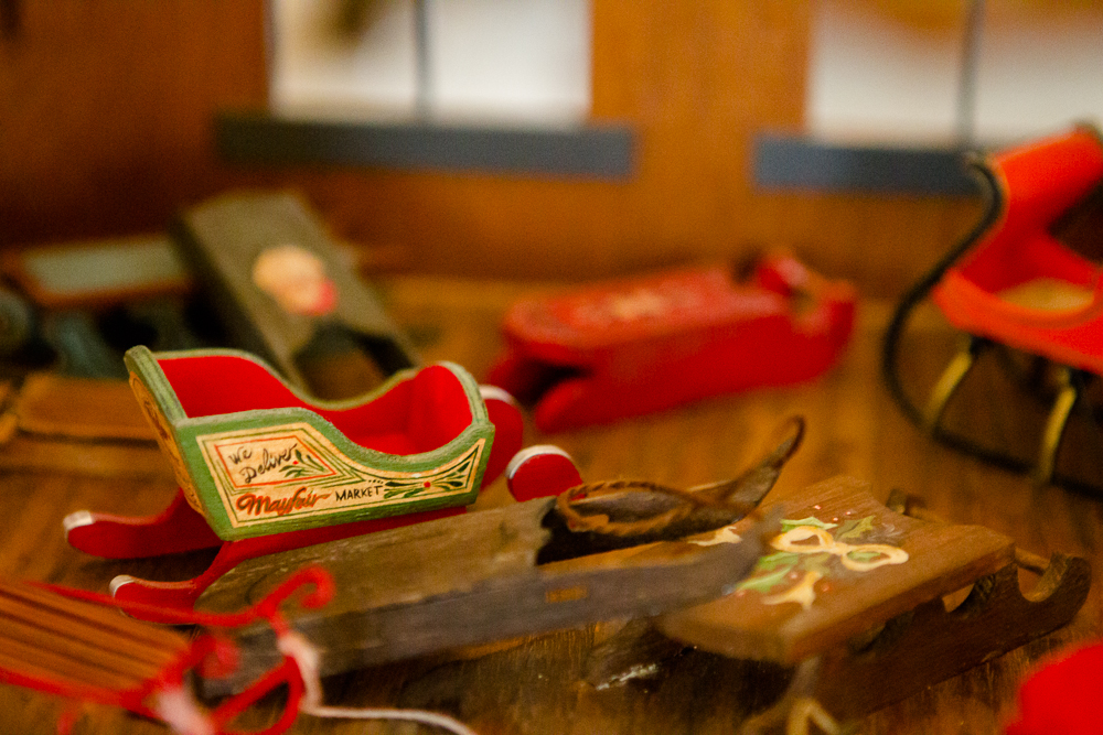 . A fleet of miniature sleds are part of the decorations at the governor\'s mansion. Photo by Mark Broste