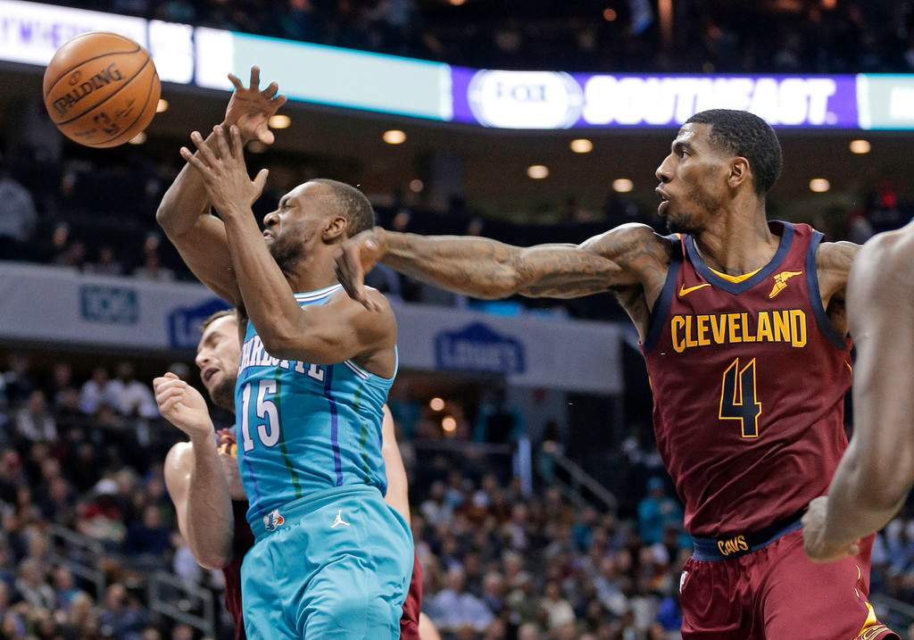 . Charlotte Hornets\' Kemba Walker (15) is fouled by Cleveland Cavaliers\' Iman Shumpert (4) during the first half of an NBA basketball game in Charlotte, N.C., Wednesday, Nov. 15, 2017. (AP Photo/Chuck Burton)