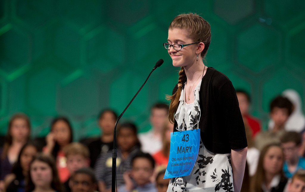 ". Mary Horton, 13, of West Melbourne, Fla., expresses her disappointment after incorrectly spelling ""shibuichi\"" during the finals of the Scripps National Spelling Bee, Thursday, May 29, 2014, at National Harbor in Oxon Hill, Md.  (AP Photo/Manuel Balce Ceneta)"