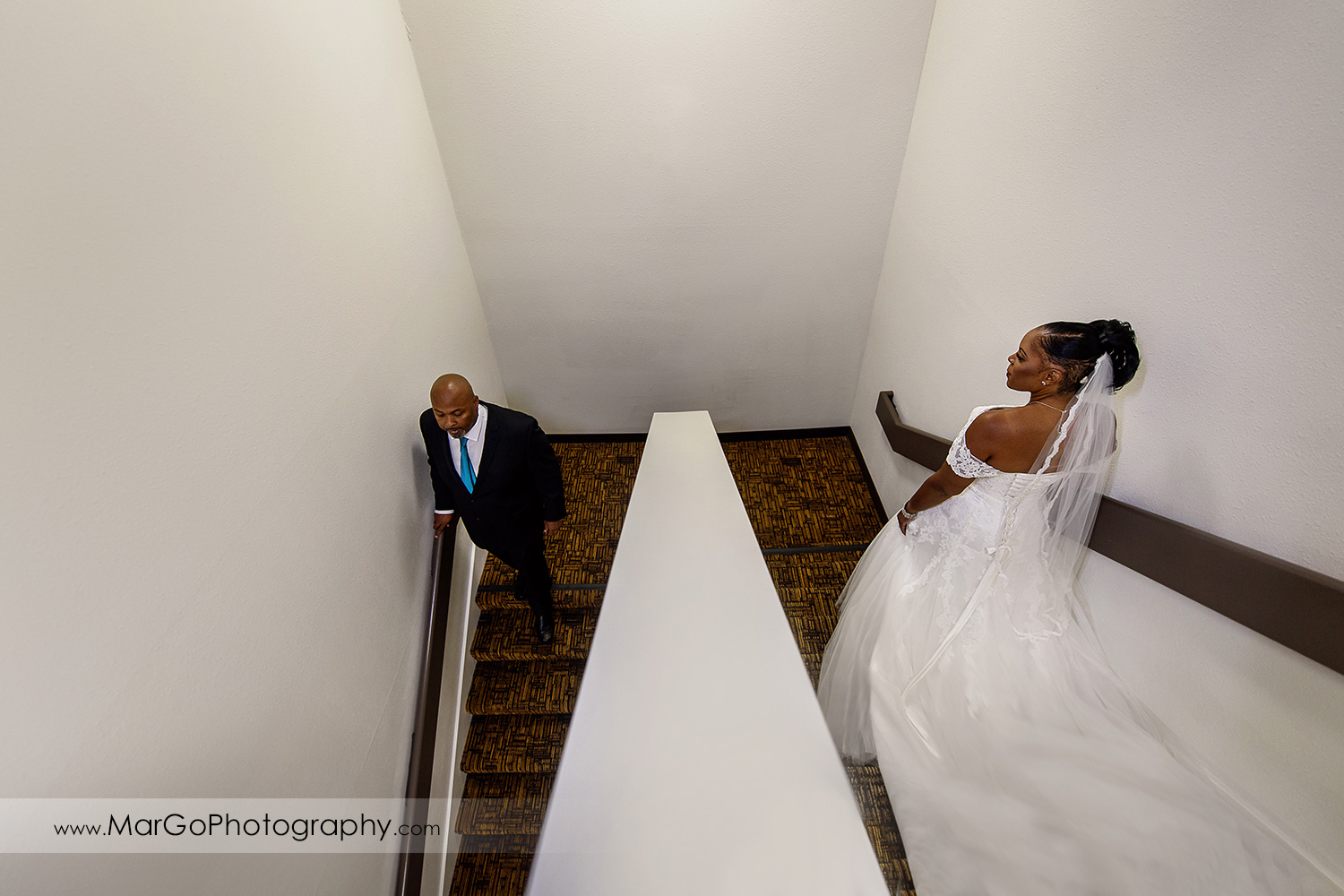 bride and groom on the stairs at Best Western Plus Delta Inn & Suites in Oakley