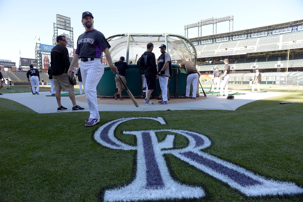 . Todd Helton (17) of the Colorado Rockies takes batting practice for the last time as a member of the Colorado Rockies September 25, 2013 at Coors Field. Helton will retire at the end of the season after 17 years with the club. (Photo By John Leyba/The Denver Post)