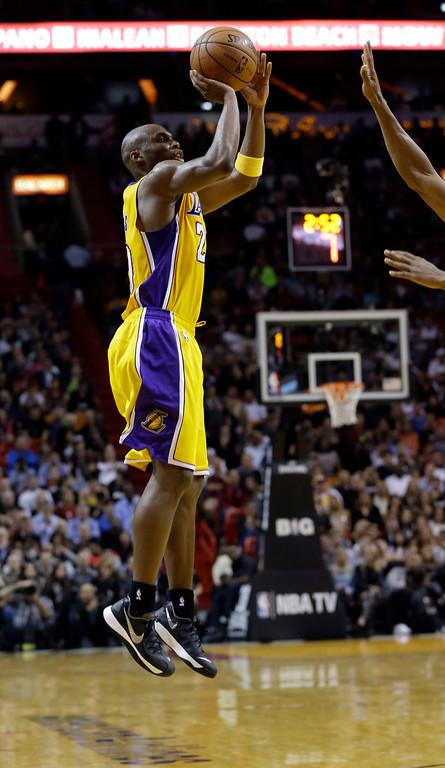 . Los Angeles Lakers guard Jodie Meeks (20)  goes up for a three-point shot against the the Miami Heat during the fourth quarter of an NBA basketball game in Miami, Thursday, Jan. 23, 2014. The Heat won 109-102. (AP Photo/Alan Diaz)