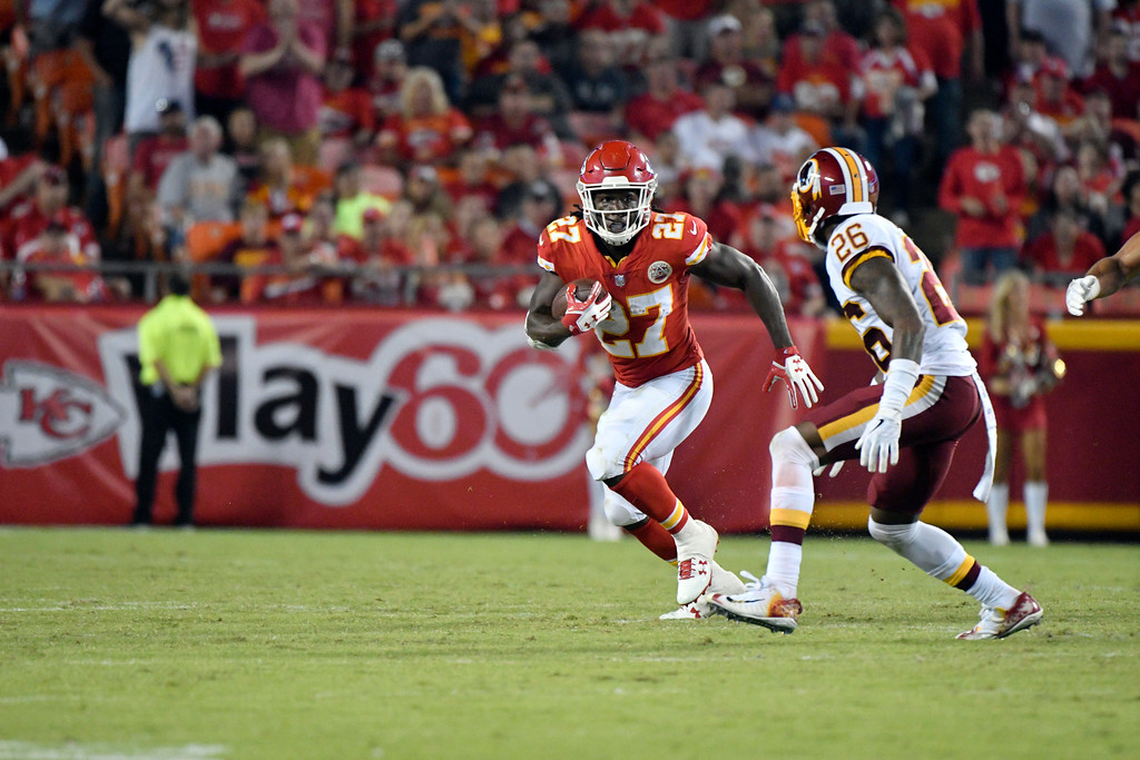 . Kansas City Chiefs running back Kareem Hunt (27) runs away from Washington Redskins cornerback Bashaud Breeland (26) during the second half of an NFL football game in Kansas City, Mo., Monday, Oct. 2, 2017. (AP Photo/Ed Zurga)