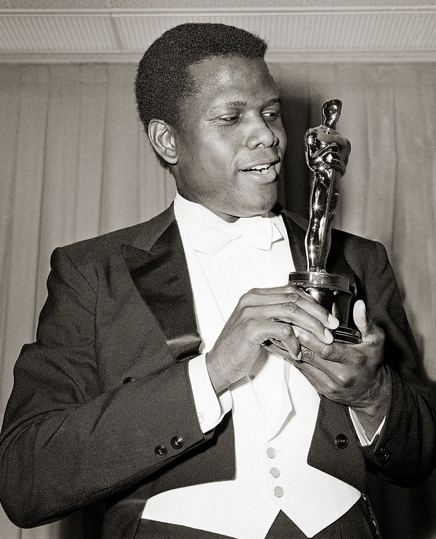 ". Actor Sidney Poitier is photographed with his Oscar statuette at the 36th Annual Academy Awards in Santa Monica, Calif. on April 13, 1964. He won Best Actor for his role in ""Lillies of the Field.\""   Poitier became the first black person to win an Academy Award for Best Actor. (AP Photo)"