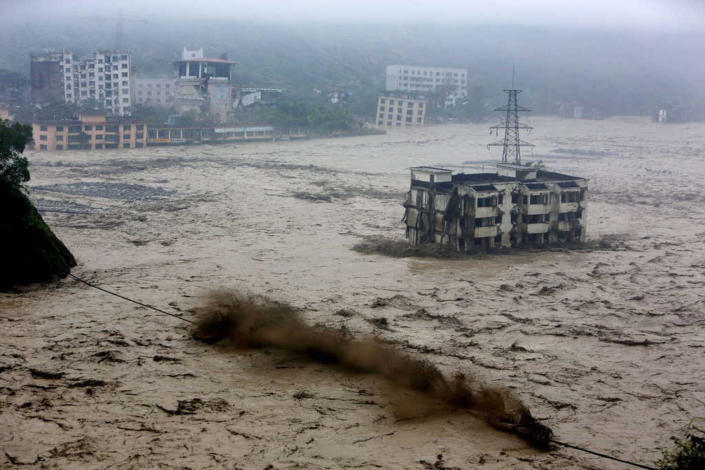 . Hheavy flood waters sweep through Beichuan in southwest China\'s Sichuan province.    AFP/AFP/Getty Images