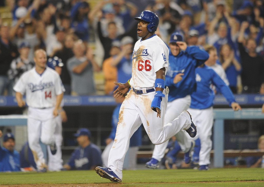 . Yasiel Puig heads home after being driven in on a Adrian Gonzalez double to win the game. The Dodgers defeated the New York Mets 5-4 in 12 innings at Dodger Stadium in Los Angeles, CA. 8/13/2013(John McCoy/LA Daily News)