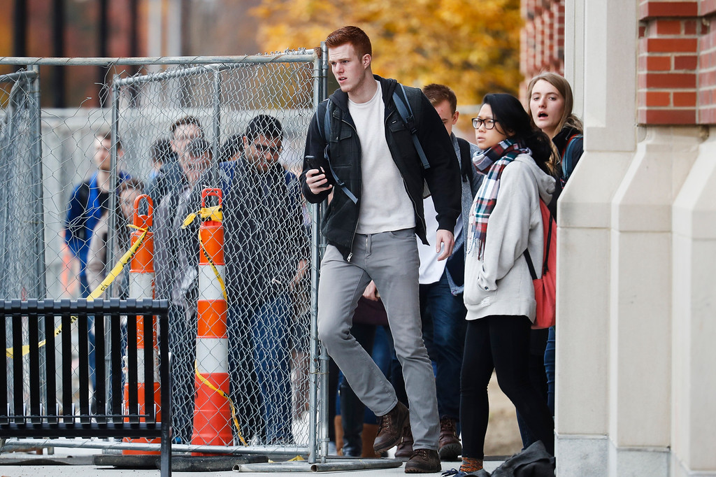 . Students leave buildings as police respond to an attack on campus at Ohio State University, Monday, Nov. 28, 2016, in Columbus, Ohio. (AP Photo/John Minchillo)
