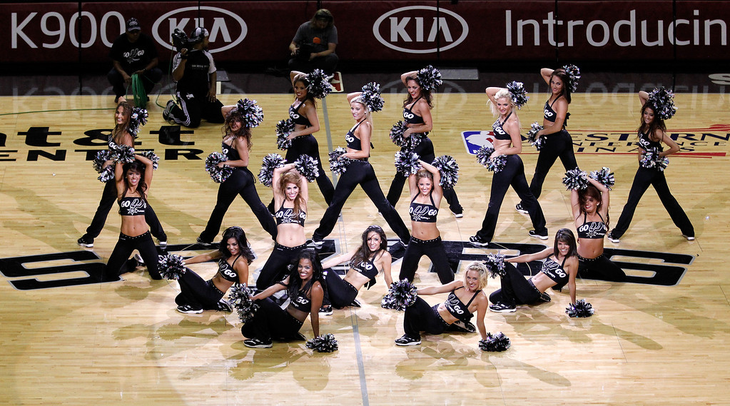 . The San Antonio Spurs cheerleaders perform during a break in the game against the Oklahoma City Thunder in Game Two of the Western Conference Finals during the 2014 NBA Playoffs at AT&T Center on May 21, 2014 in San Antonio, Texas.   (Photo by Chris Covatta/Getty Images)