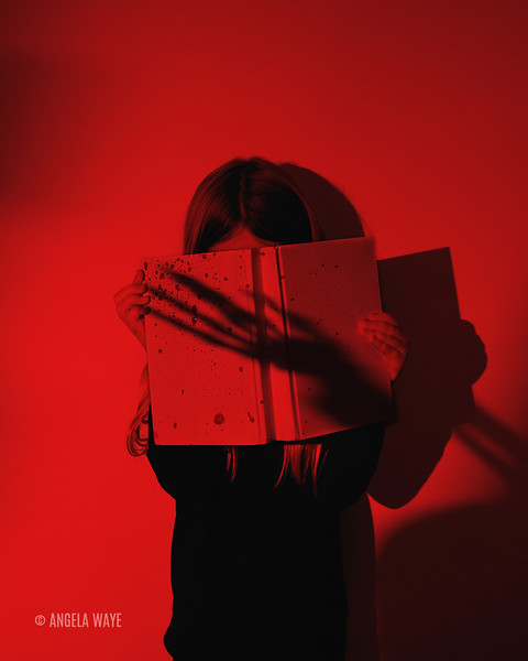 Girl Reading Scary Book wit Hand Shadow