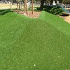 mound with garden bed of artificial turf