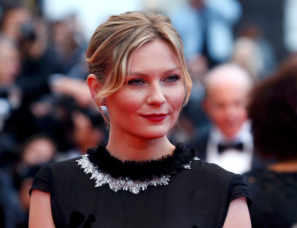 ". Actress Kirsten Dunst poses on the red carpet as she arrives for the screening of the film ""Inside Llewyn Davis\"" in competition during the 66th Cannes Film Festival in Cannes May 19, 2013.   REUTERS/Jean-Paul Pelissier"