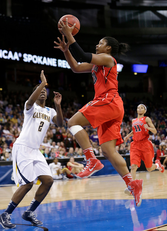 . Georgia\'s Shacobia Barbee, right, drives the lane in front of California\'s Afure Jemerigbe during the first half in a regional final in the NCAA women\'s college basketball tournament, Monday, April 1, 2013, in Spokane, Wash. (AP Photo/Elaine Thompson)