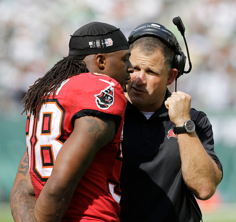 . Tampa Bay Buccaneers coach Greg Schiano, right, talks to free safety Dashon Goldson in the second half of an NFL football game against the New York Jets, Sunday, Sept. 8, 2013, in East Rutherford, N.J. (AP Photo/Mel Evans)