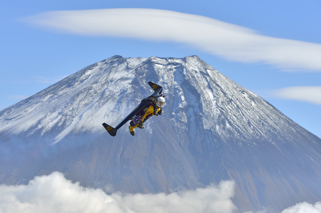 . In this photo taken Friday, Nov. 1, 2013 and provided by Breitling, Yves Rossy, known as the Jetman, flies by Mount Fuji in Japan.  (AP Photo/Katsuhiko Tokunaga, Breitling)