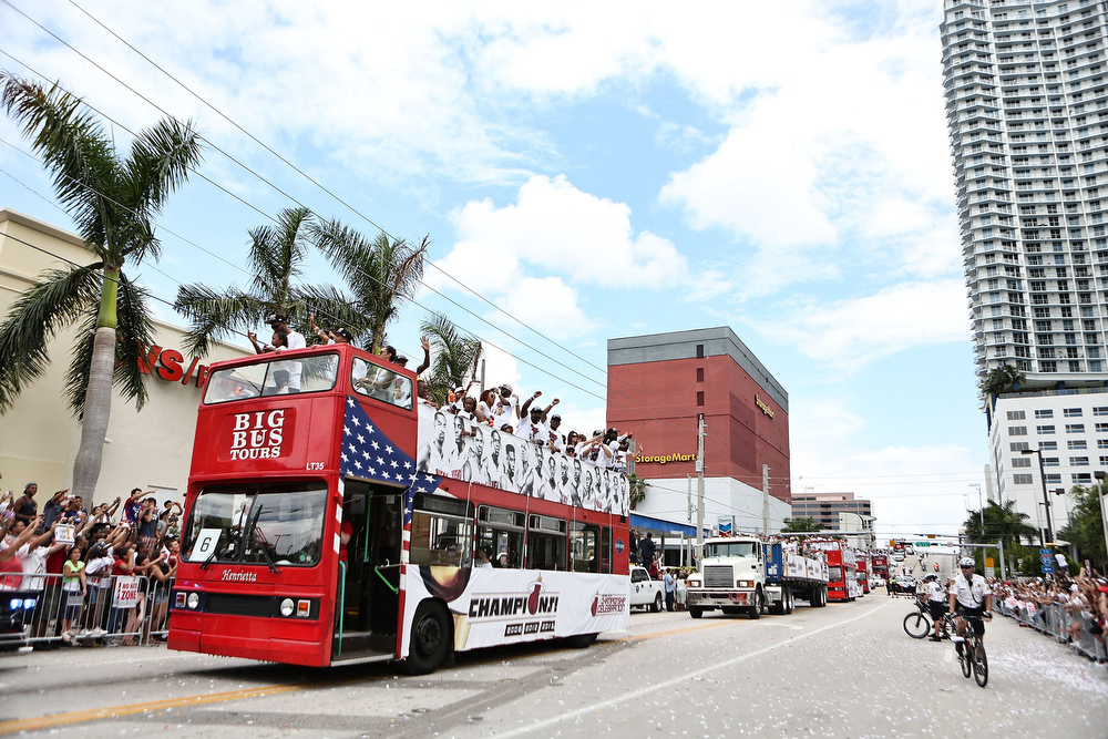 . Members of the Miami Heat ride a bus during the NBA championship victory parade on the streets on June 24, 2013 in Miami, Florida. The Miami Heat defeated the San Antonio Spurs in the NBA Finals. (Photo by Marc Serota/Getty Images)