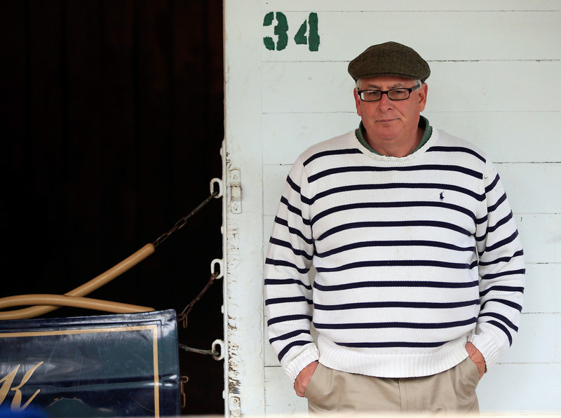 . Jimmy Jerkens, trainer of Kentucky Derby entrant Wicked Strong, watches from the barn area during early morning workouts at Churchill Downs on May 1, 2014 in Louisville, Kentucky.  (Photo by Jamie Squire/Getty Images)