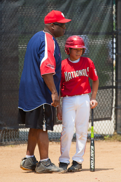 Coach Coop making sure Alex knows he has to swing at anything from the nose down in the top of the 4th inning. The bats of the Nationals were supported by a great defensive outing in a 11-4 win over the Twins. They are now 7-3 for the season. 2012 Arlington Little League Baseball, Majors Division. Nationals vs Twins (13 May 2012) (Image taken by Patrick R. Kane on 13 May 2012 with Canon EOS-1D Mark III at ISO 400, f4.0, 1/2000 sec and 280mm)