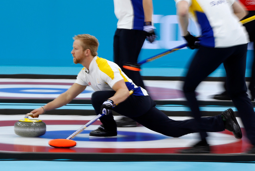 . Swedenís skip Niklas Edin delivers the rock during men\'s curling competition against Norway at the 2014 Winter Olympics, Thursday, Feb. 13, 2014, in Sochi, Russia. (AP Photo/Robert F. Bukaty)