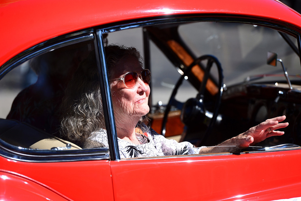. Nita Carey is driven by Dan Rankin in a XK140 Jaguar in City of Duarte\'s annual Route 66 Parade along Huntington Drive, on Saturday, September 28, 2013. (Photo by Sarah Reingewirtz/Pasadena Star-News)