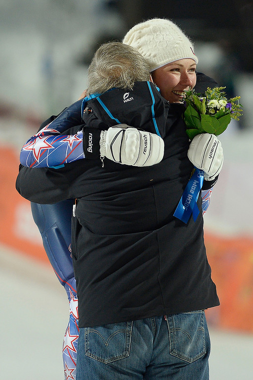 . Gold medalist Mikaela Shiffrin hugs U.S. Ski President Bill Marolt after ladies\' slalom run 2. Sochi 2014 Winter Olympics on Friday, February 21, 2014 at Rosa Khutor Alpine Center. (Photo by AAron Ontiveroz/ The Denver Post)
