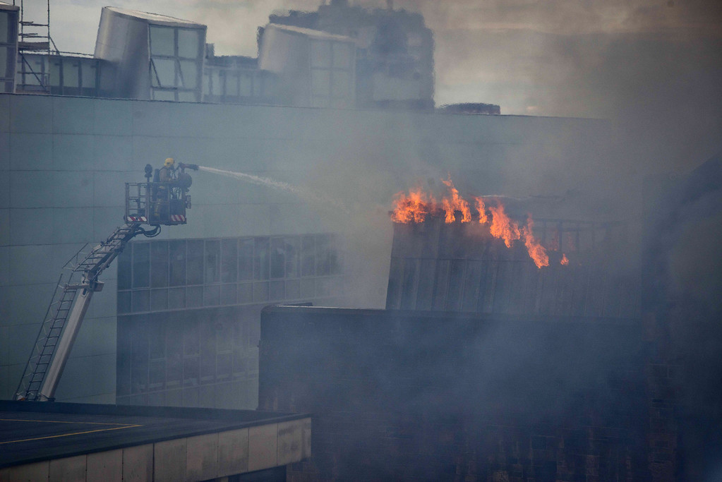 . A firefighter works to put out a fire at the Glasgow School of Art Charles Rennie Mackintosh Building on May 23, 2014 in Glasgow, Scotland.  (Photo by Chris Watt/Getty Images)