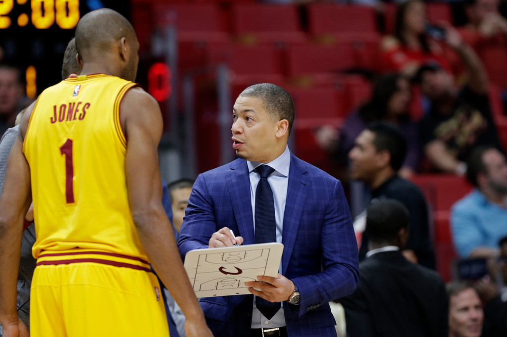. Cleveland Cavaliers head coach Tyronn Lue talks with guard James Jones (1) during the first half of an NBA basketball game against the Miami Heat, Saturday, March 4, 2017, in Miami. (AP Photo/Lynne Sladky)