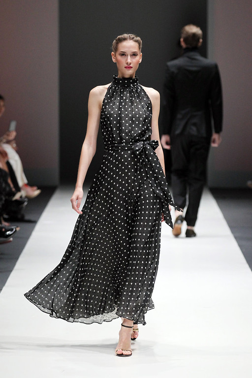 . A model showcases an outfit by New York based designer Carolina Herrera for the Fall 2013 collection, \'The House of Herrera\' on Wednesday, May 15, 2013 in Singapore during the annual Fashion Festival held in the city-state.(AP Photo/Wong Maye-E)