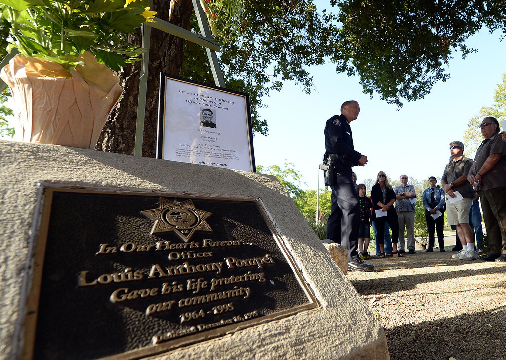 . Glendora Police Chief Tim Staab, a and former colleague of Glendora Police Officer Louis Anthony Pompei, speaks at his memorial on Puente Street in San Dimas Monday afternoon June 9, 2014. Pompei was killed in the line of duty at a near by market during a robbery attempt in June 1995. (Will Lester/Inland Valley Daily Bulletin)