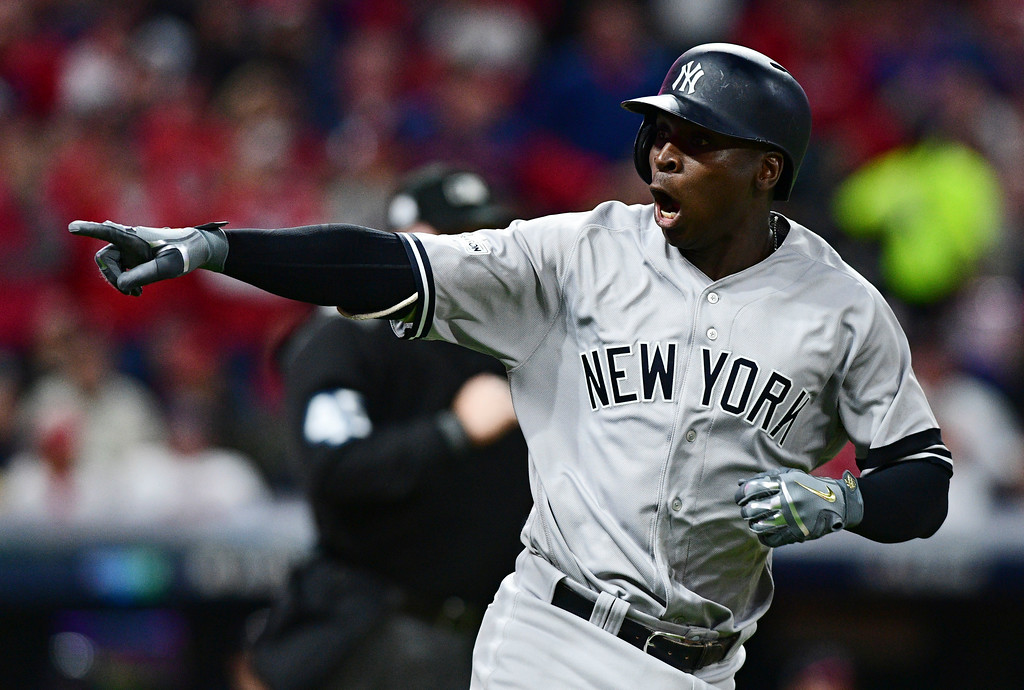 . New York Yankees\' Didi Gregorius points to the dugout after hitting a two-run home run off Cleveland Indians starting pitcher Corey Kluber during the third inning of Game 5 of a baseball American League Division Series, Wednesday, Oct. 11, 2017, in Cleveland. (AP Photo/David Dermer)