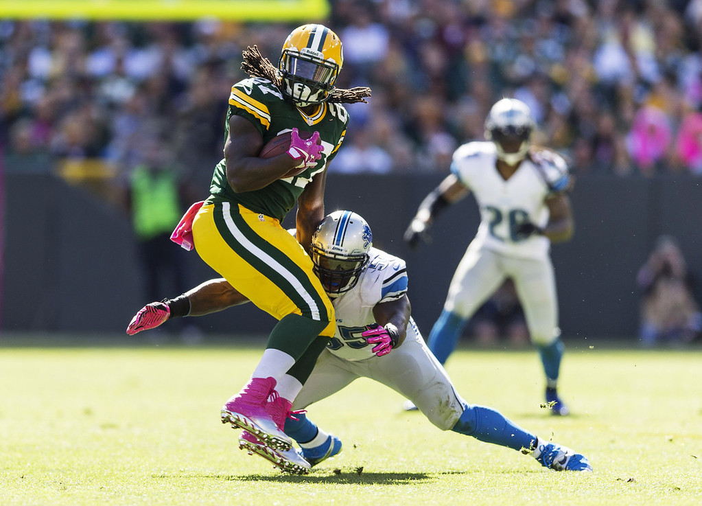 . Eddie Lacy #27 of the Green Bay Packers tries to spin away from Stephen Tulloch #55 of the Detroit Lions at Lambeau Field on October 6, 2013 in Green Bay, Wisconsin.  (Photo Tom Lynn /Getty Images)