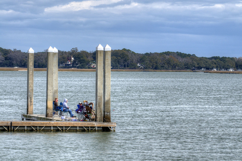 A group of people fish on a pier at the boat ramp at the Sands Beach in Port Royal, SC on Saturday, February 21, 2015. Copyright 2015 Jason Barnette
