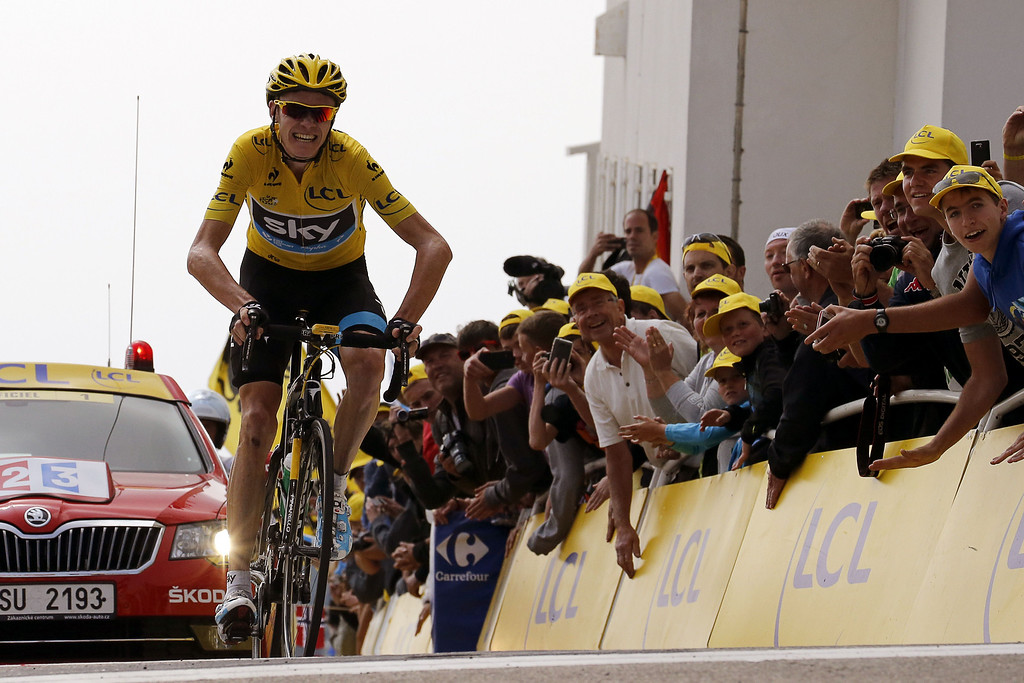 . Overall leader Christopher Froome of Britain celebrates as he crosses the finish line at the end of the 242.5 km fifteenth stage of the 100th edition of the Tour de France cycling race on July 14, 2013 between Givors and Mont Ventoux, southeastern France.    JOEL SAGET/AFP/Getty Images