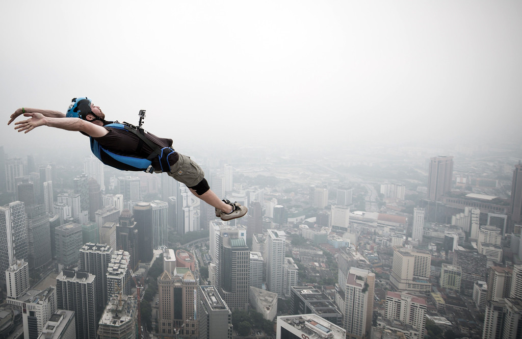 . Base jumper Julien Dominique Briquez from France leaps from the 300-metres Open Deck of the Malaysia\'s landmark Kuala Lumpur Tower during the International Tower Jump in Kuala Lumpur on September 27, 2013.    AFP PHOTO / MOHD RASFANMOHD RASFAN/AFP/Getty Images
