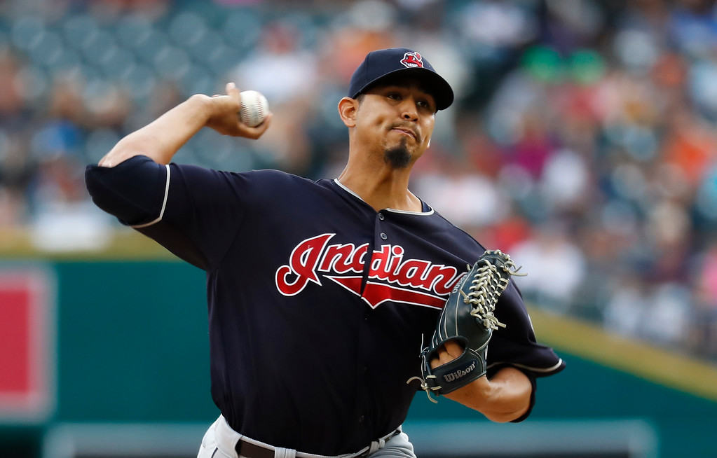 . Cleveland Indians pitcher Carlos Carrasco throws against the Detroit Tigers in the first inning of a baseball game in Detroit, Friday, July 27, 2018. (AP Photo/Paul Sancya)