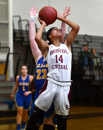 12/31/2019 MIke Orazzi | StaffrBristol Central's Damani Hough (14) and Gilbert's Ajla Gutic (23) during Tuesday's girls basketball game at Bristol Central in Bristol.