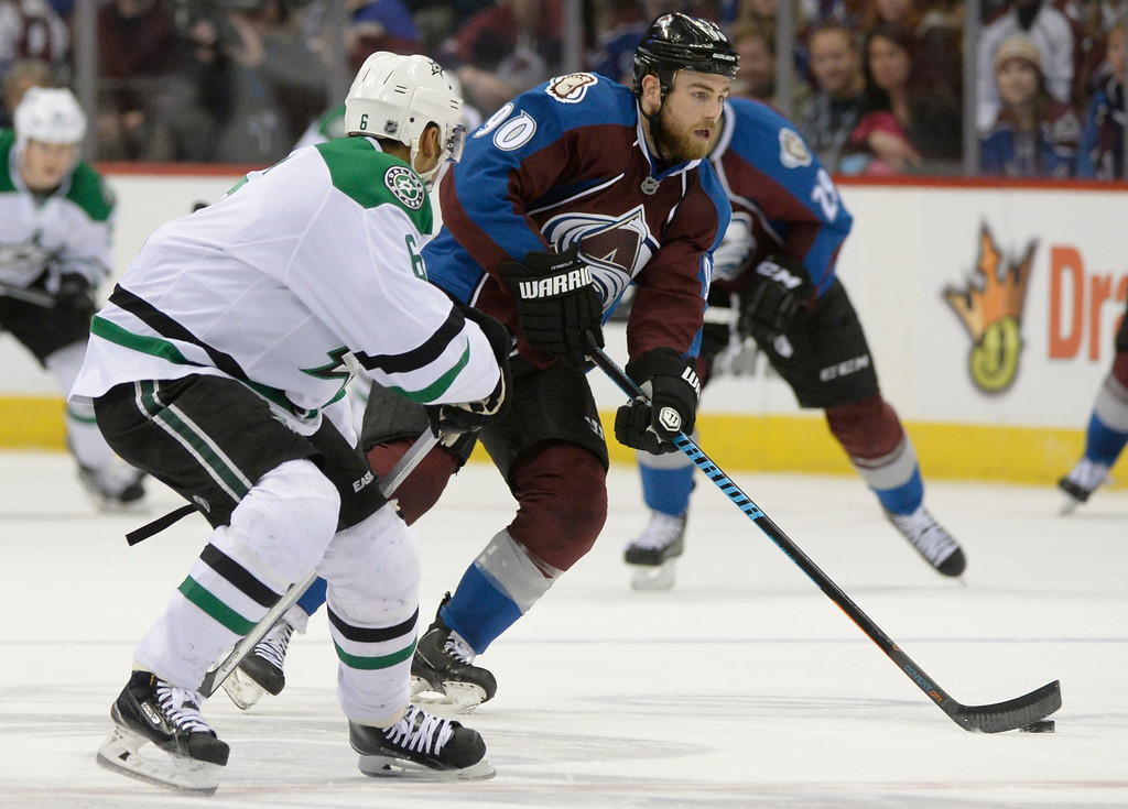 . Colorado Avalanche center Ryan O\'Reilly (90) prepares to take a shot on goal while being defended by Dallas Stars defenseman Trevor Daley (6) during the third period Saturday, February 14, 2015 at the Pepsi Center in Denver, Colorado. (Photo By Brent Lewis/The Denver Post)