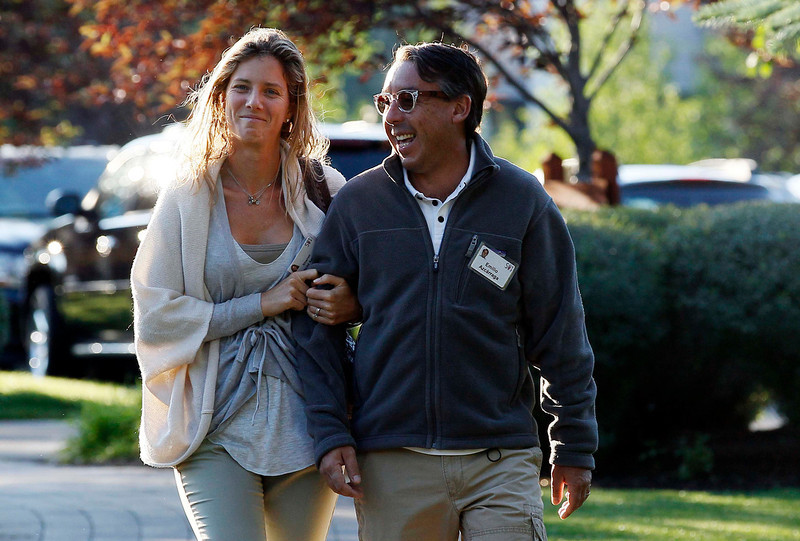 . Emilio Azcarraga (R), CEO of Groupo Televisa, arrives with Sharon Fastlicht Azcarraga for the first session of the annual Allen and Co. conference at the Sun Valley, Idaho Resort July 10, 2013.  REUTERS/Rick Wilking