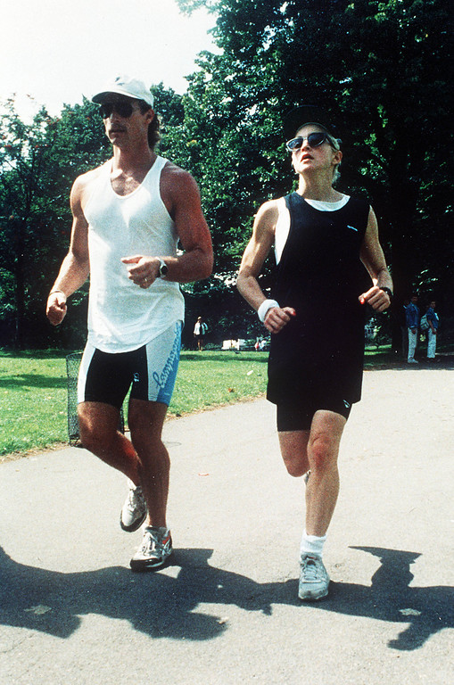 . U.S. pop star Madonna takes a run in London\'s Green Park, Aug. 14, 1987, with one of her bodyguards. Madonna arrived in Britain yesterday for a series of concerts. (AP Photo/Gerald Penny)