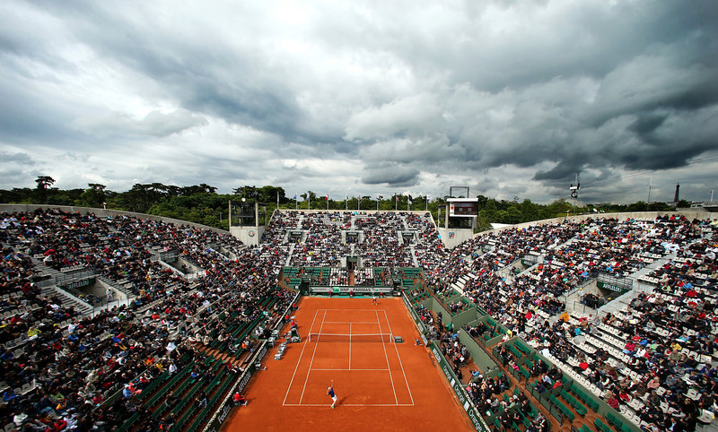 . A general view of Suzanne Lenglen court as Tommy Haas of Germany serves in his Men\'s Singles match against Guillaume Rufin of France during day three of the French Open at Roland Garros on May 28, 2013 in Paris, France.  (Photo by Matthew Stockman/Getty Images)