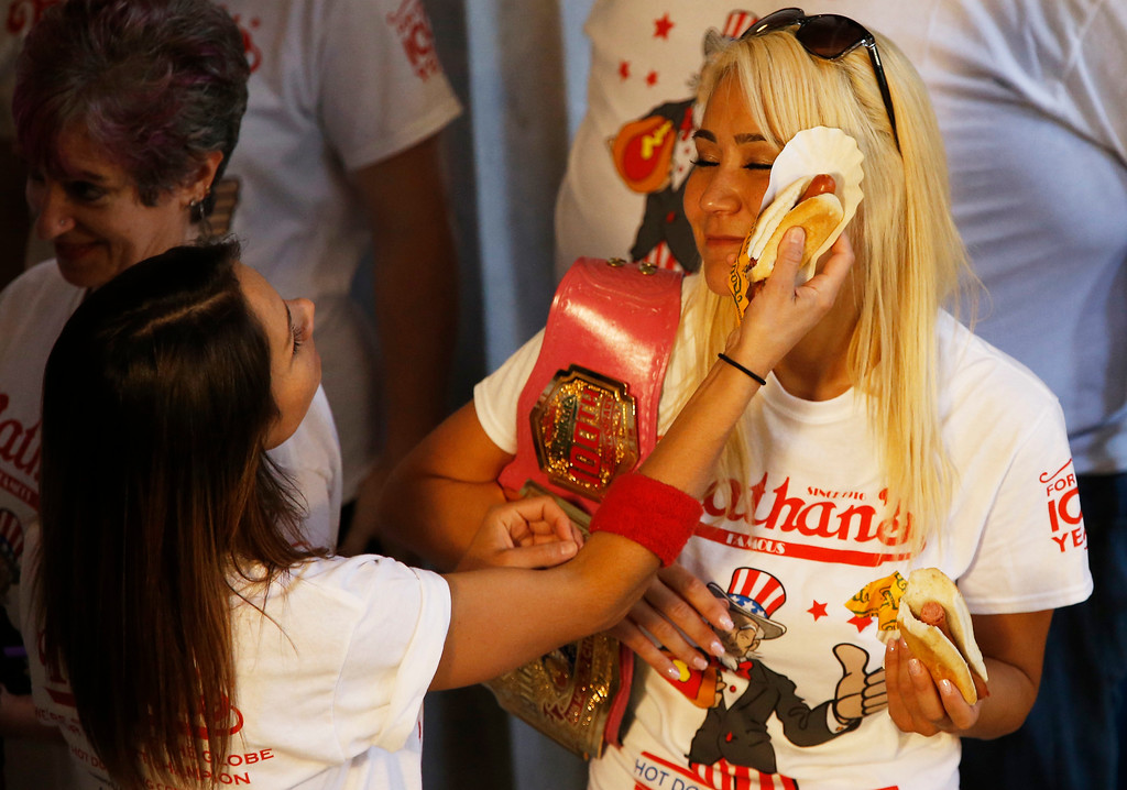 . Michelle Lesco, left, of Tucson, AZ and Miki Sudo, Las Vegas, NV, the woman hot dog-eating champion joke after the weight in for the Nathan\'s Famous Hotdog eating contest Monday, July 3, 2017, in Brooklyn, New York. (AP Photo/Michael Noble)