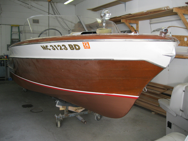 Front starboard view of bottom painted and water line applied.