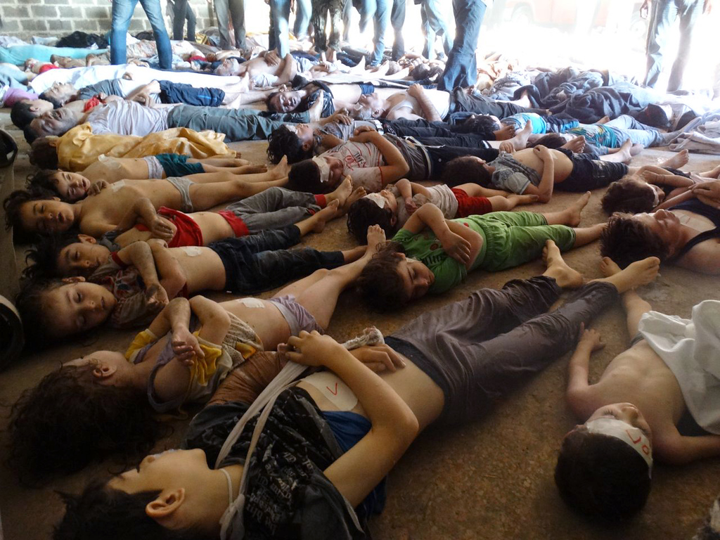 """. GRAPHIC CONTENT A handout image released by the Syrian opposition\'s Shaam News Network shows bodies of children and adults laying on the ground as Syrian rebels claim they were killed in a toxic gas attack by pro-government forces in eastern Ghouta, on the outskirts of Damascus on August 21, 2013. The allegation of chemical weapons being used in the heavily-populated areas came on the second day of a mission to Syria by UN inspectors. It was promptly denied by the Syrian authorities.  AFP PHOTO/HO/SHAAM NEWS NETWORK     == RESTRICTED TO EDITORIAL USE - MANDATORY CREDIT \""""AFP PHOTO / HO / SHAAM NEWS NETWORK\"""" - NO MARKETING NO ADVERTISING CAMPAIGNS - DISTRIBUTED AS A SERVICE TO CLIENTS - AFP IS USING PICTURES FROM ALTERNATIVE SOURCES AS IT WAS NOT AUTHORISED TO COVER THIS EVENT, THEREFORE IT IS NOT RESPONSIBLE FOR ANY DIGITAL ALTERATIONS TO THE PICTURE\'S EDITORIAL CONTENT, DATE AND LOCATION WHICH CANNOT BE INDEPENDENTLY VERIFIED ==-/AFP/Getty Images"""