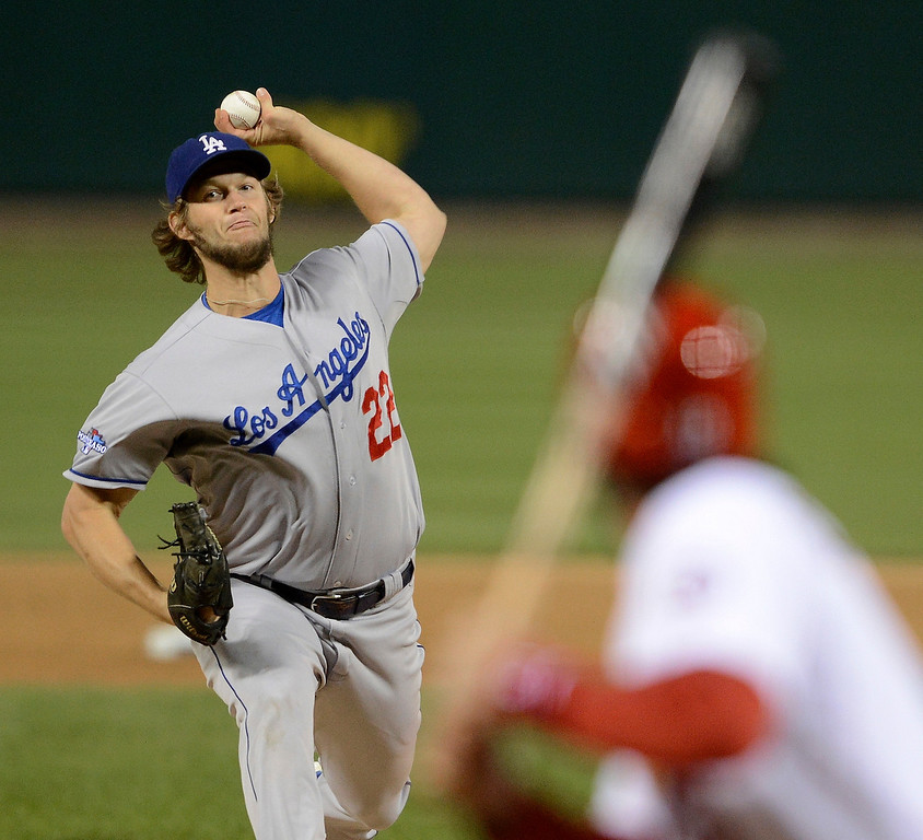 . Los Angeles Dodgers starting pitcher Clayton Kershaw throws during the first inning of Game 6 of the National League baseball championship series against the St. Louis Cardinals  Friday, Oct. 18, 2013, in St. Louis. (AP Photo/David Klutho, Pool)
