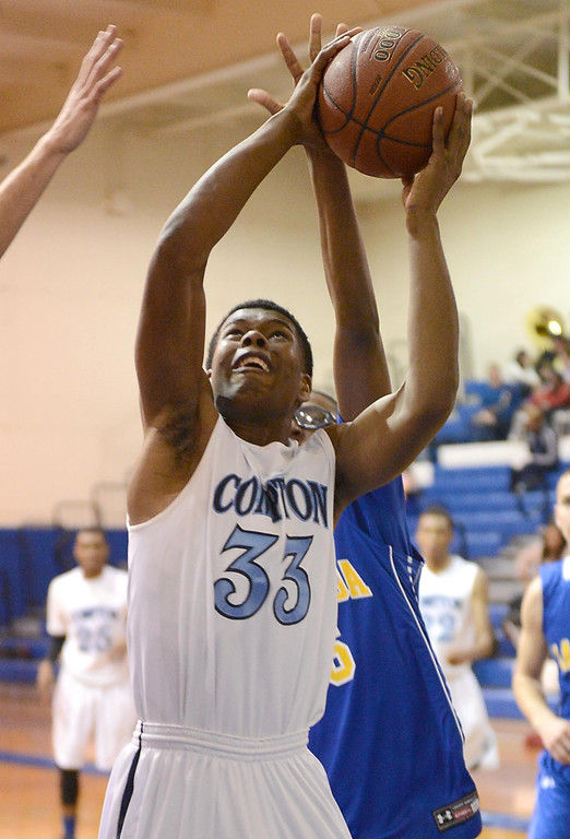 . Compton\'s Tramelle Pritchett (33) shoots against La Mirada in a first round CIF Division 3AAA basketball game Wednesday night in Compton. 20130213 Photo by Steve McCrank / Staff Photographer