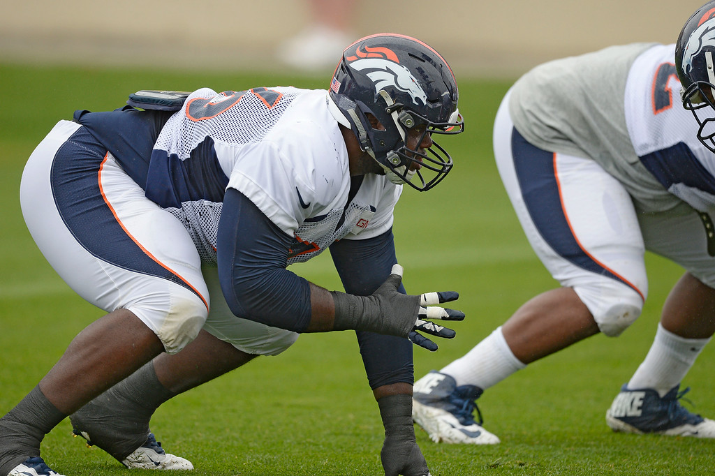 . Denver Broncos defensive tackle Marvin Austin (76) lines up during drills on day seven of the Denver Broncos 2014 training camp July 31, 2014 at Dove Valley. (Photo by John Leyba/The Denver Post)