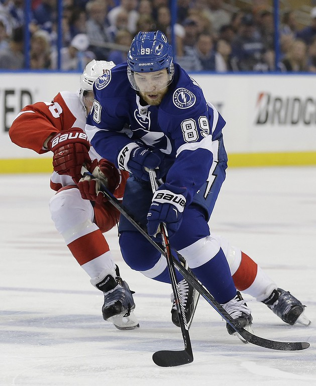 . Tampa Bay Lightning defenseman Nikita Nesterov (89), of Russia, gets around Detroit Red Wings center Joakim Andersson (18), of Sweden, during the second period of Game 7 of a first-round NHL Stanley Cup hockey playoff series Wednesday, April 29, 2015, in Tampa, Fla. (AP Photo/Chris O\'Meara)