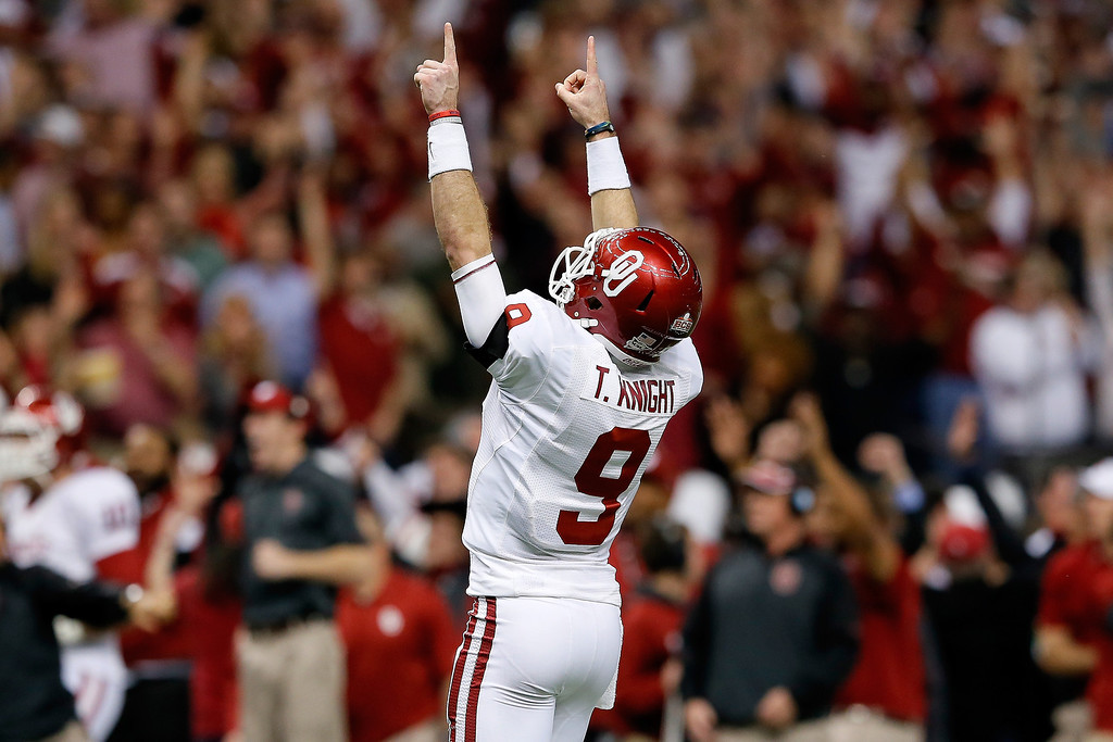. NEW ORLEANS, LA - JANUARY 02:  Trevor Knight #9 of the Oklahoma Sooners reacts after a touchdown against the Alabama Crimson Tide during the Allstate Sugar Bowl at the Mercedes-Benz Superdome on January 2, 2014 in New Orleans, Louisiana.  (Photo by Kevin C. Cox/Getty Images)