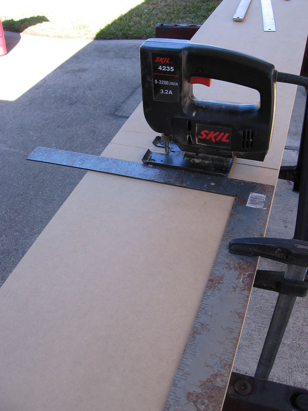 Then you place the blade of your saw on the line, clamp a carpenters square to the board to guide the saw, and cut. I've shown a skil saw here, which you can use, but a circular saw with a plywood blade would be more precise.