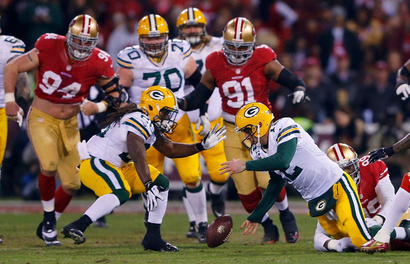 . Green Bay Packers Aaron Rodgers (C) recovers his own fumble as he is tackled by San Francisco 49ers Aldon Smith (R) next to teammate DuJuan Harris (L) in the second quarter during their NFL NFC Divisional playoff football game in San Francisco, California, January 12, 2013. REUTERS/Mike Blake