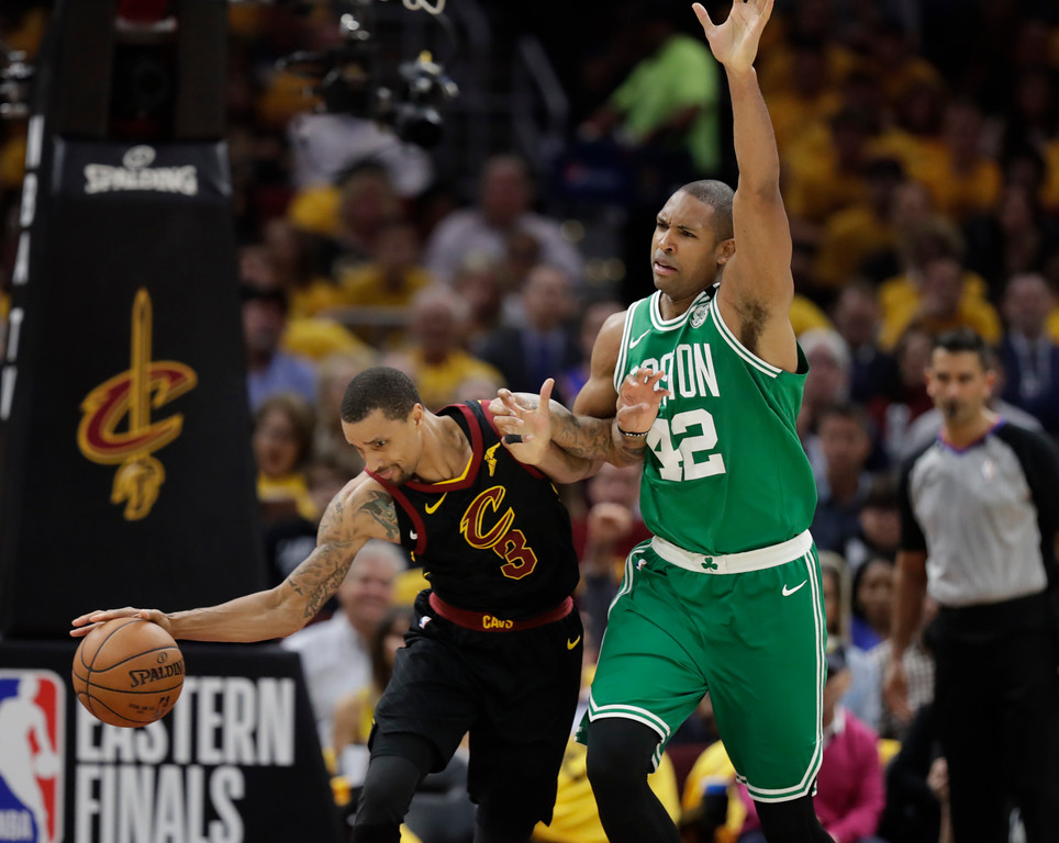 . Cleveland Cavaliers\' George Hill (3) controls the ball as Boston Celtics\' Al Horford (42), from Dominican Republic, defends in the first half of Game 3 of the NBA basketball Eastern Conference finals, Saturday, May 19, 2018, in Cleveland. (AP Photo/Tony Dejak)